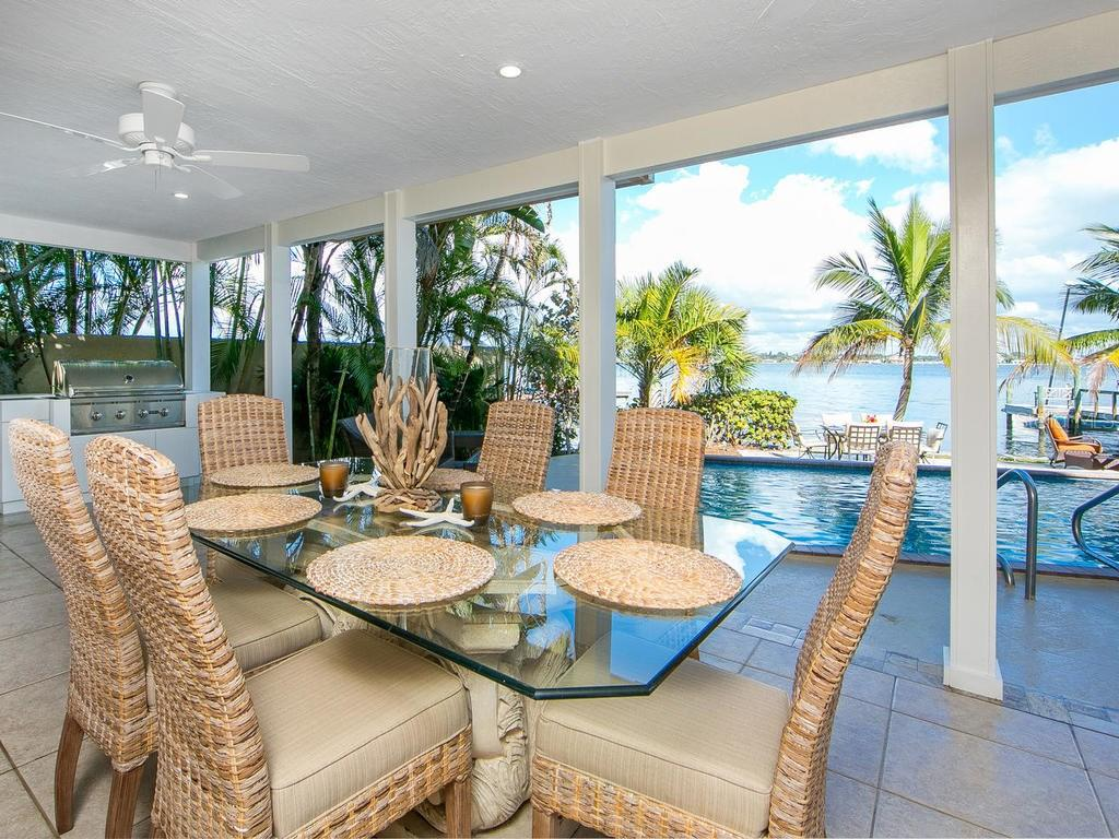 Covered lanai dining area with Intracoastal views - Single Family Home for sale at 8101 Midnight Pass Rd, Sarasota, FL 34242 - MLS Number is A4206718