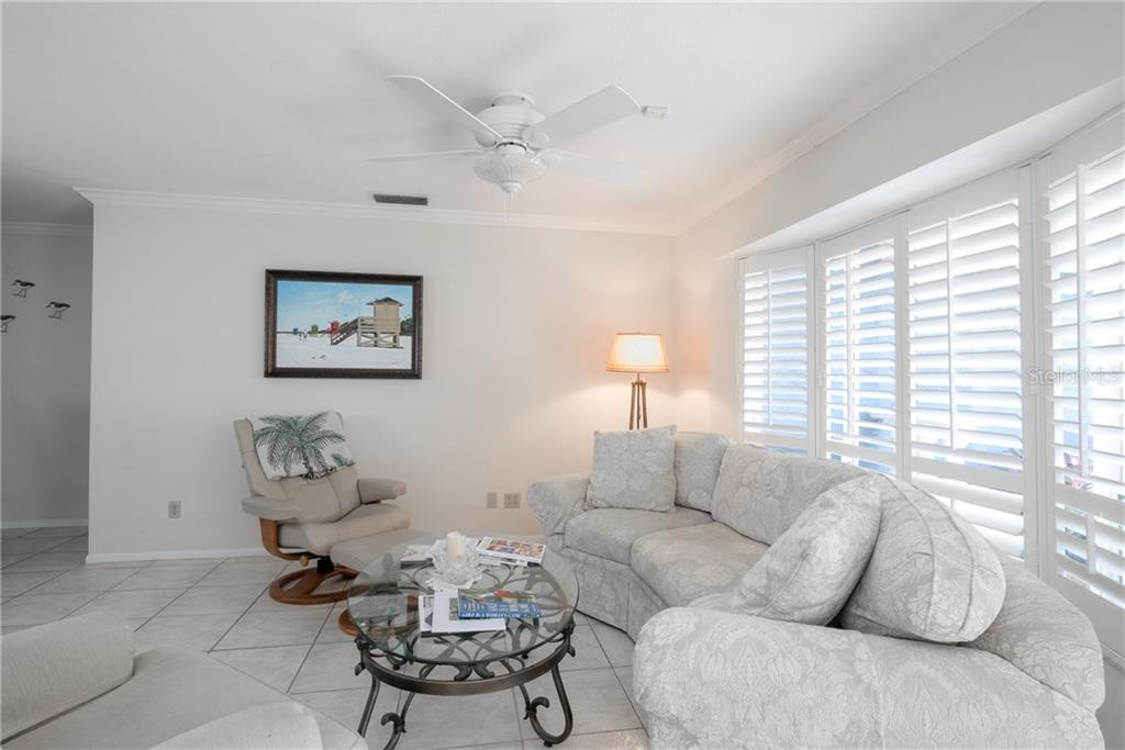 Living room, flooded with natural light. - Single Family Home for sale at 5633 Cape Leyte Dr, Sarasota, FL 34242 - MLS Number is A4207008