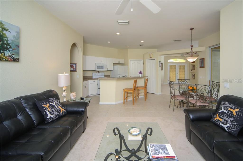 Family room - Single Family Home for sale at 1876 Bushnell Ave, North Port, FL 34286 - MLS Number is A4207073