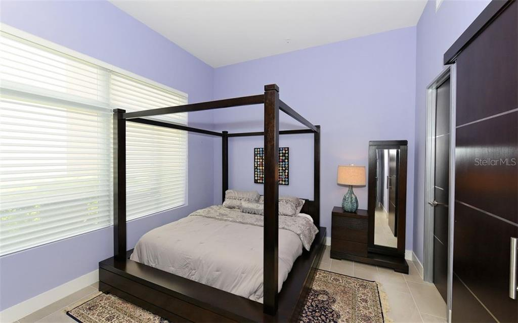 Downstairs guest bedroom - Townhouse for sale at 234 Cosmopolitan Ct, Sarasota, FL 34236 - MLS Number is A4207722