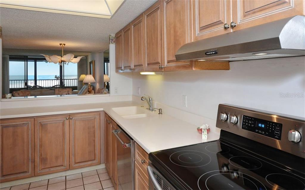 Kitchen Opened for entertaining and of course enjoying the where you live from every room - Condo for sale at 5790 Midnight Pass Rd #704, Sarasota, FL 34242 - MLS Number is A4208095