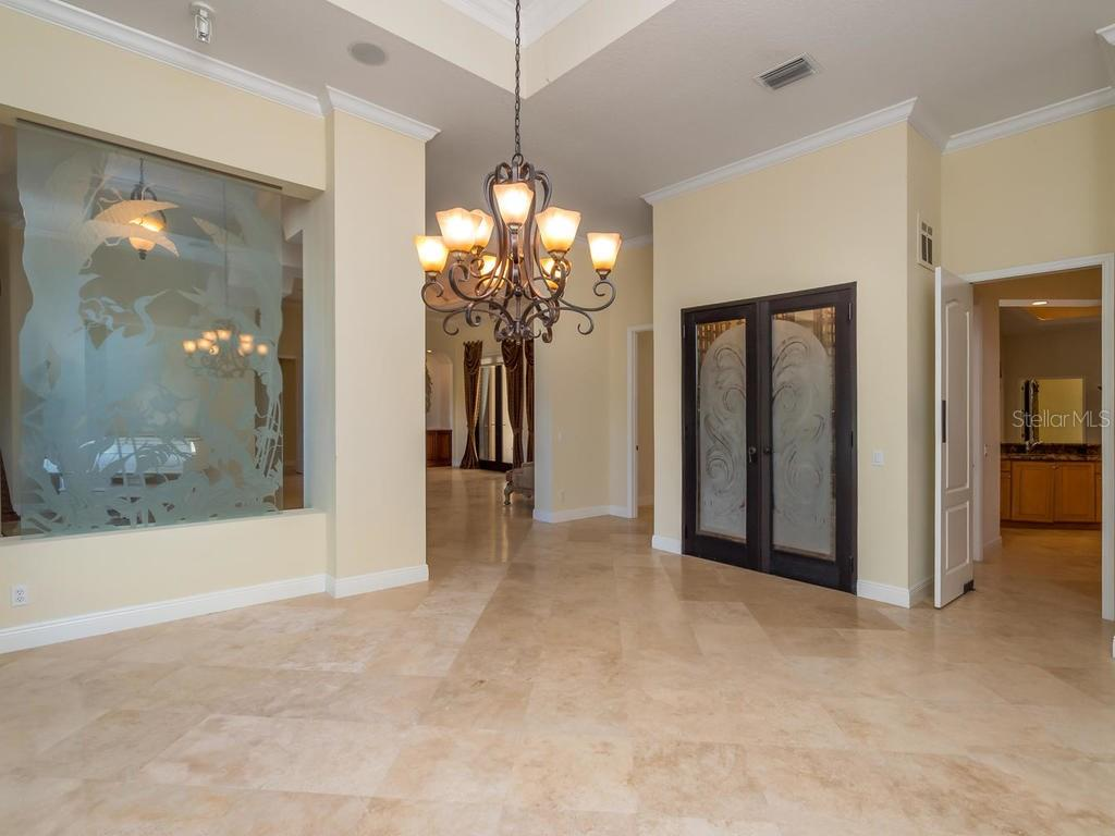 Dining Room with tray ceiling - Single Family Home for sale at 7715 Donald Ross Rd W, Sarasota, FL 34240 - MLS Number is A4208499