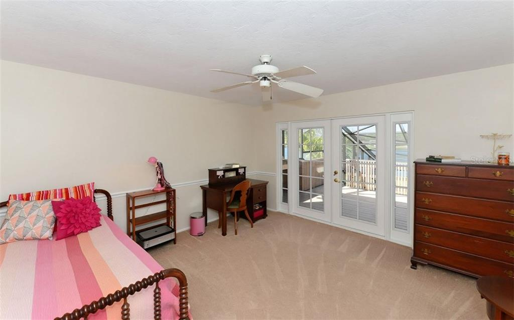 Two additional bedrooms on second level with access to the large balcony overlooking the lake. - Single Family Home for sale at 5122 Willow Leaf Dr, Sarasota, FL 34241 - MLS Number is A4209555