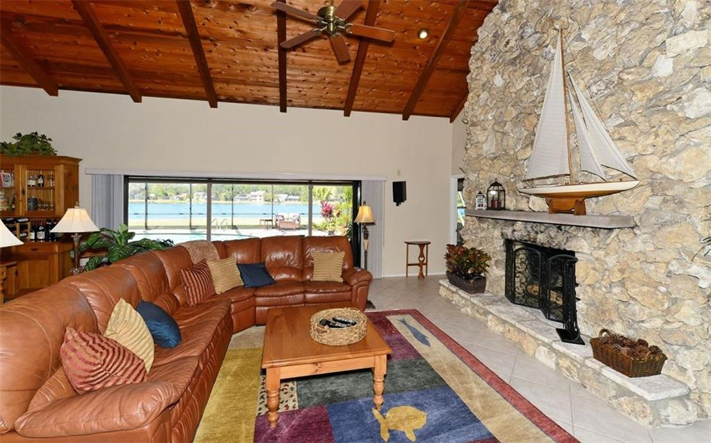 Enjoy the lake view beyond. - Single Family Home for sale at 5122 Willow Leaf Dr, Sarasota, FL 34241 - MLS Number is A4209555