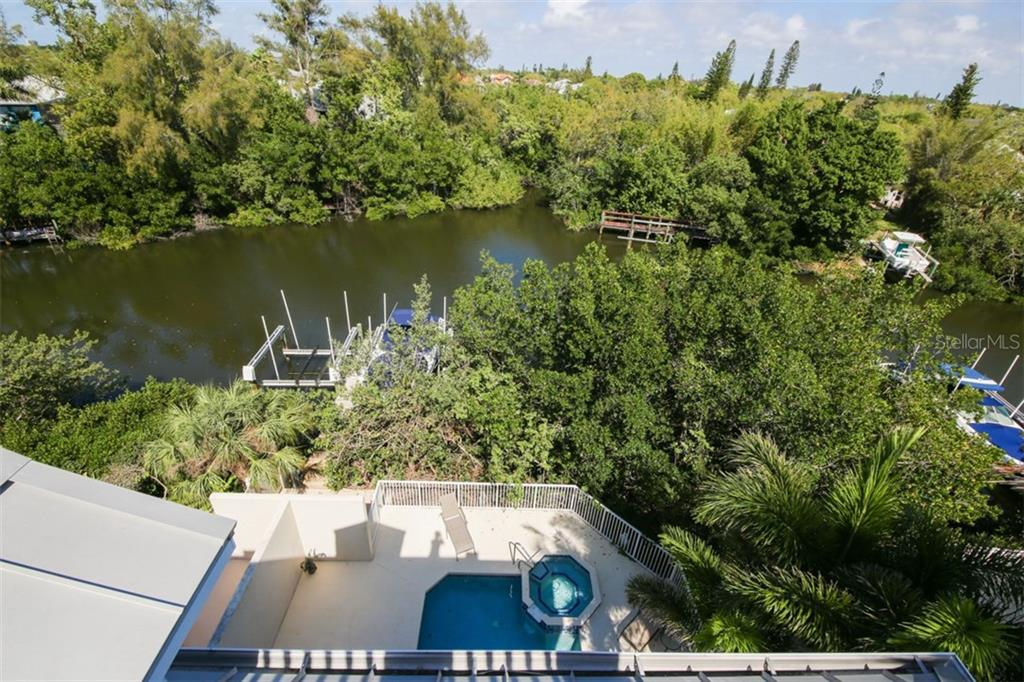 View from roof top back at pool and canal - Single Family Home for sale at 455 Canal Rd, Sarasota, FL 34242 - MLS Number is A4209817