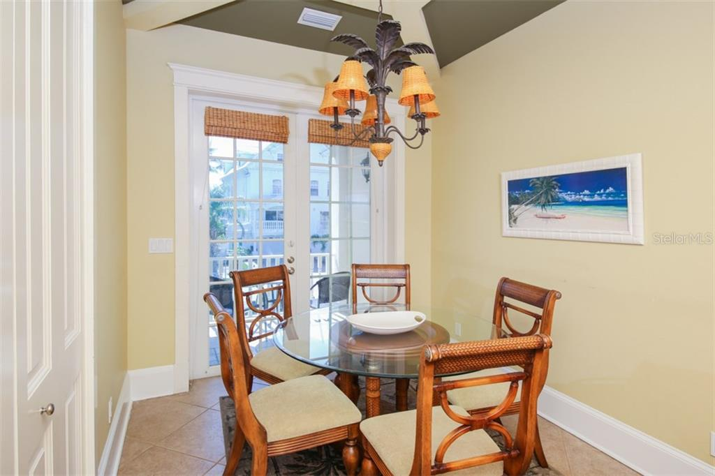 Dining nook off kitchen  - Balcony opens out to front - Single Family Home for sale at 455 Canal Rd, Sarasota, FL 34242 - MLS Number is A4209817