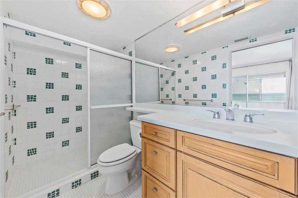 Master shower with custom tile inserts on the wall - Condo for sale at 6140 Midnight Pass Rd #608, Sarasota, FL 34242 - MLS Number is A4209897