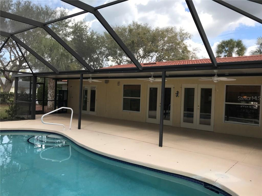 Exterior back view, swimming pool and lanai - Single Family Home for sale at 5530 Cape Leyte Dr, Sarasota, FL 34242 - MLS Number is A4209986