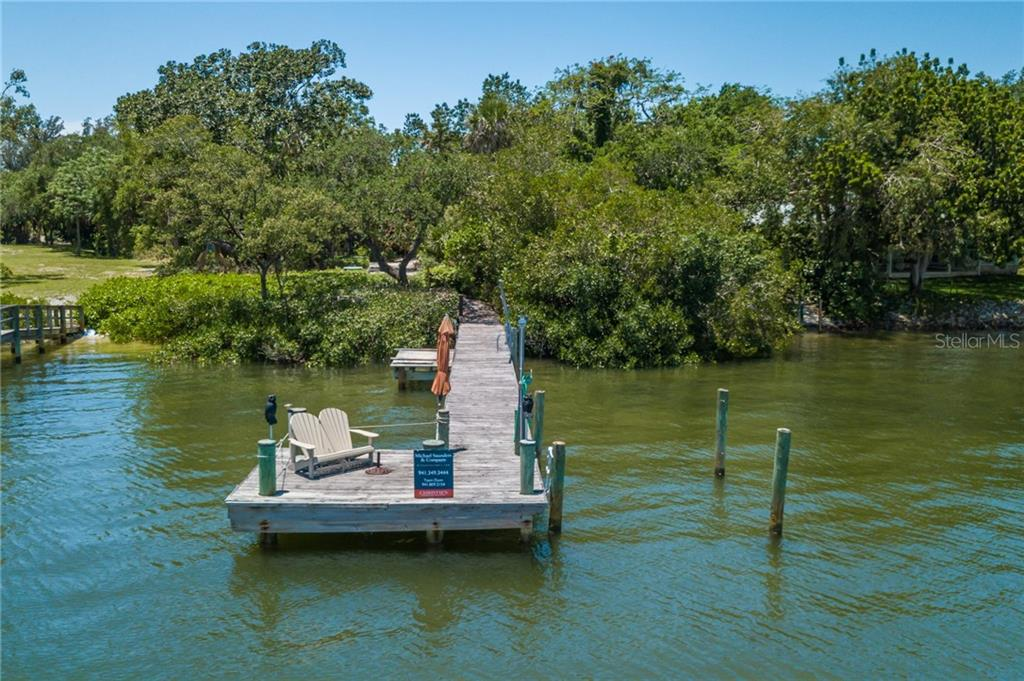 Dock Walkway - Single Family Home for sale at 6609 Peacock Rd, Sarasota, FL 34242 - MLS Number is A4210220