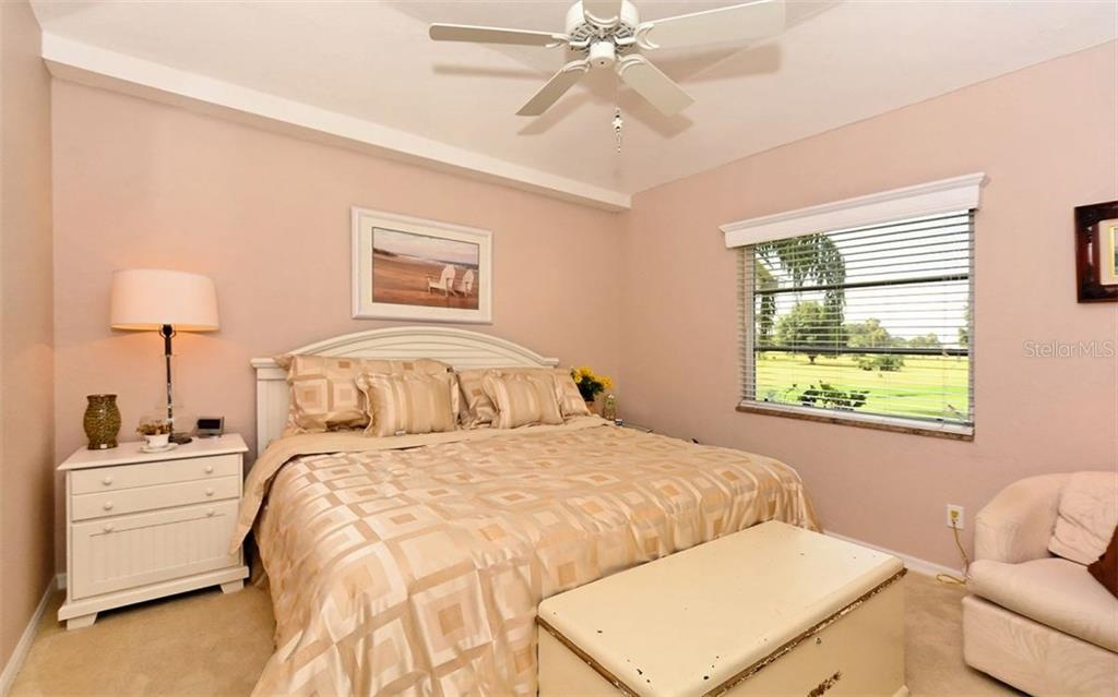 Bedroom 2 - Single Family Home for sale at 571 Khyber Ln, Venice, FL 34293 - MLS Number is A4210343