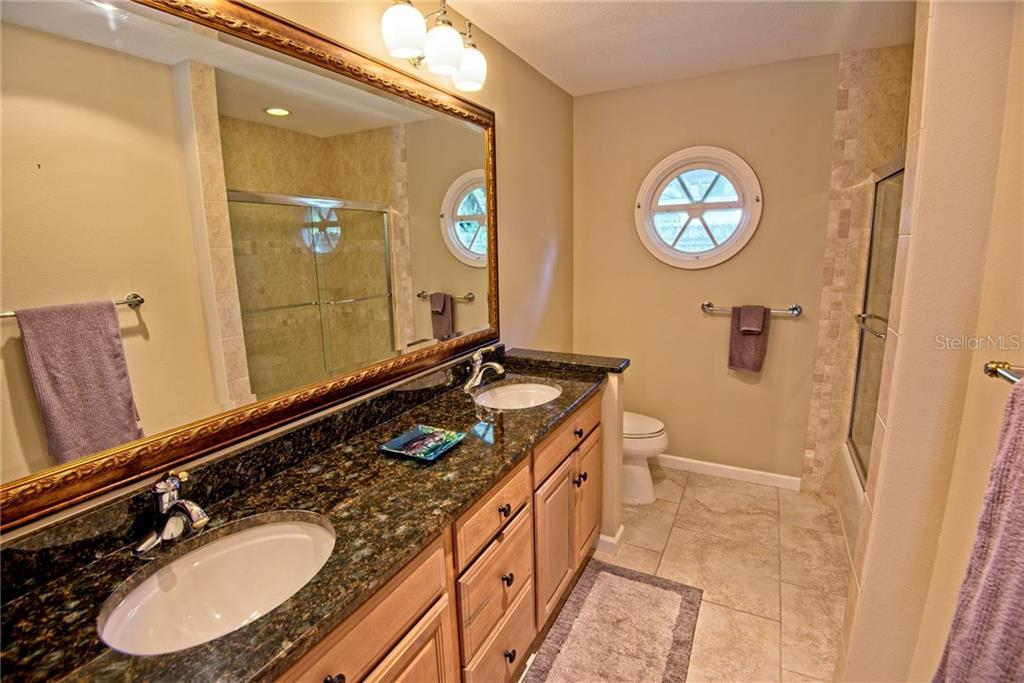 Guest bathroom with dual sinks - Single Family Home for sale at 600 Wild Turkey Ln, Sarasota, FL 34236 - MLS Number is A4210585