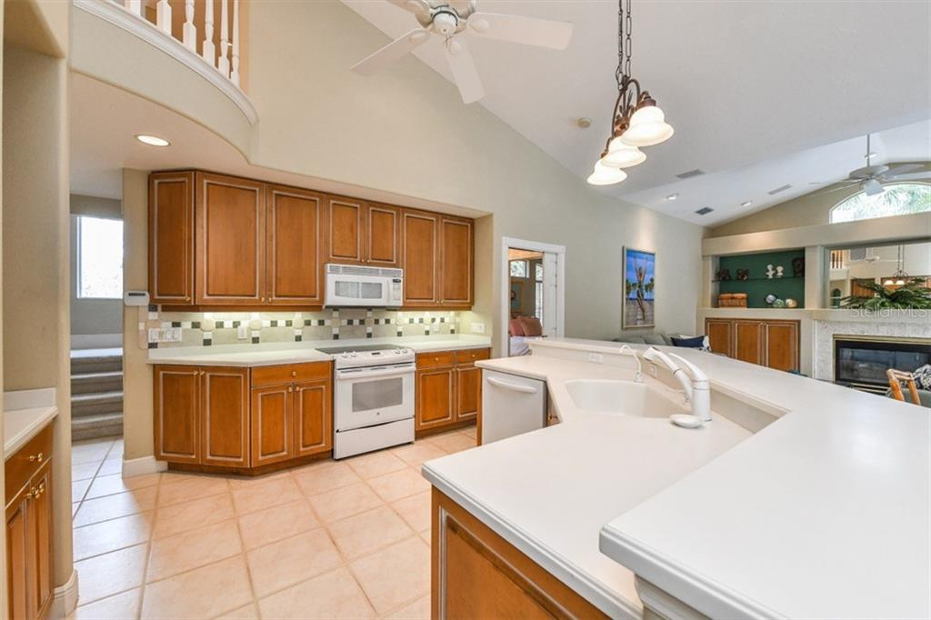 Spacious, open Kitchen overlooking the Great Room allows hosts and guests to move around easily. - Single Family Home for sale at 5585 Siesta Estates Ct, Sarasota, FL 34242 - MLS Number is A4211109