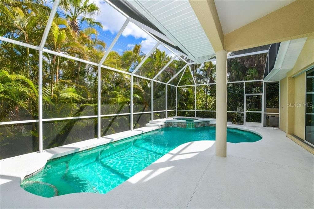 Sparkling, heated contour pool and spa!  BRAND NEW re-screened pool cage in Dec 2017.  Lanai features recessed lighting + a new ceiling fan. - Single Family Home for sale at 5585 Siesta Estates Ct, Sarasota, FL 34242 - MLS Number is A4211109