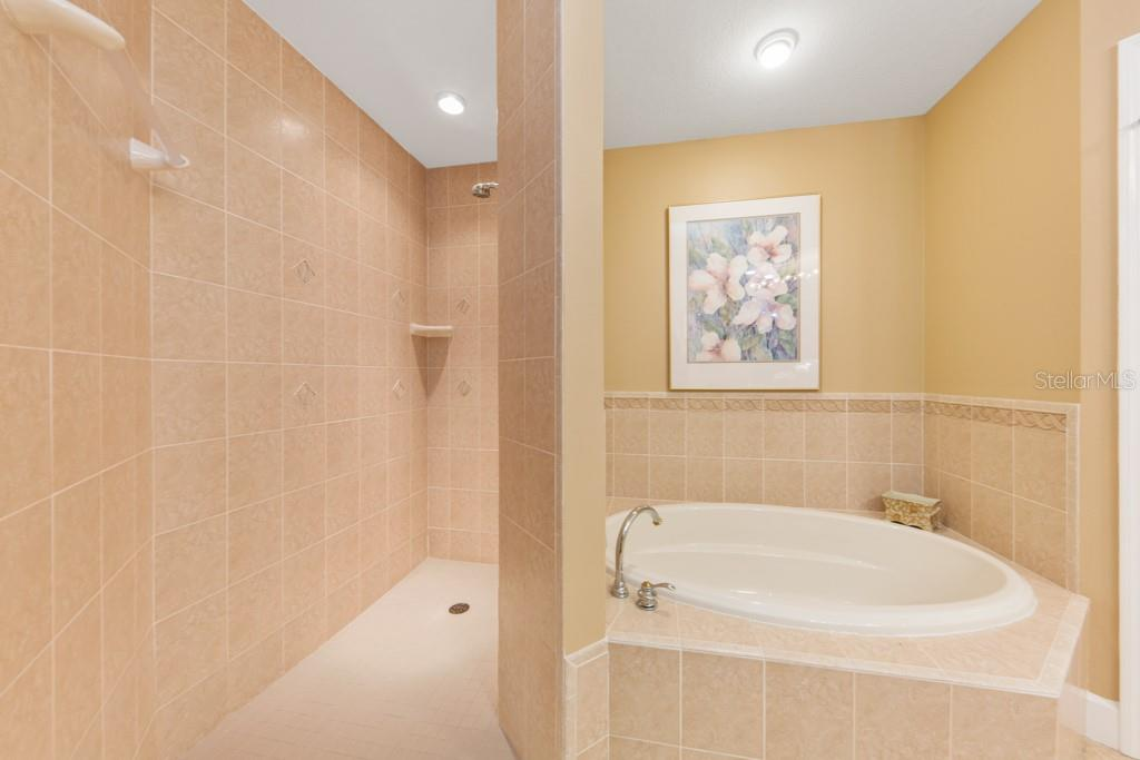 Master Bath Tub and over-sized walk-in shower - Condo for sale at 7504 Botanica Pkwy #101, Sarasota, FL 34238 - MLS Number is A4213208