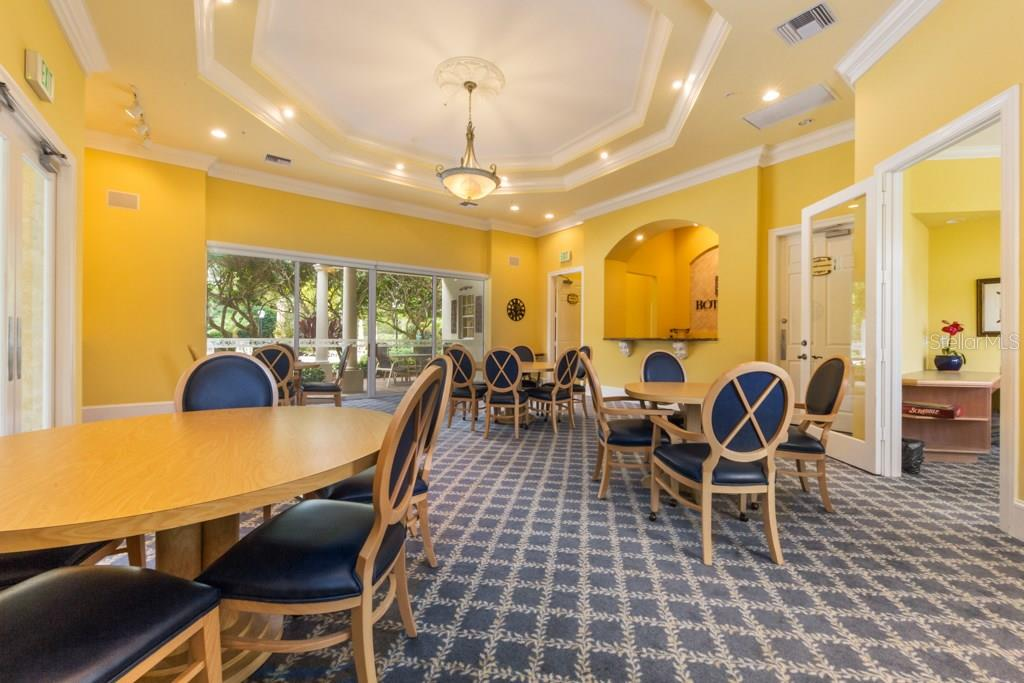 Large dining room in the clubhouse to entertain guest for large parties. - Condo for sale at 7504 Botanica Pkwy #101, Sarasota, FL 34238 - MLS Number is A4213208