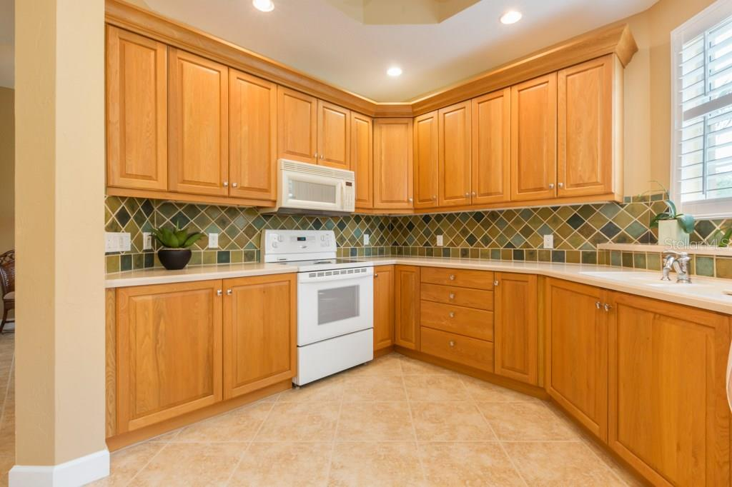 A generous amount of kitchen cabinets and counter-top space for storage and prep. - Condo for sale at 7504 Botanica Pkwy #101, Sarasota, FL 34238 - MLS Number is A4213208