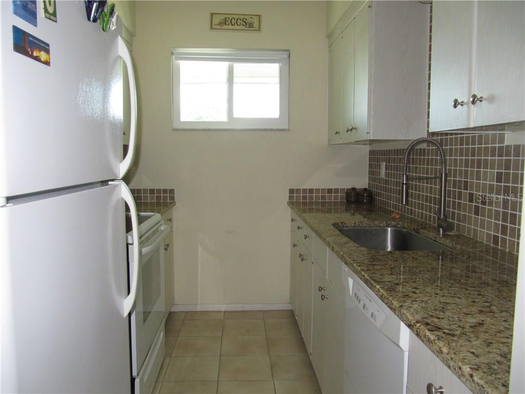 Kitchen with Granite Counters and Replacement Windows - Condo for sale at 3465 Bee Ridge Rd #323, Sarasota, FL 34239 - MLS Number is A4213622