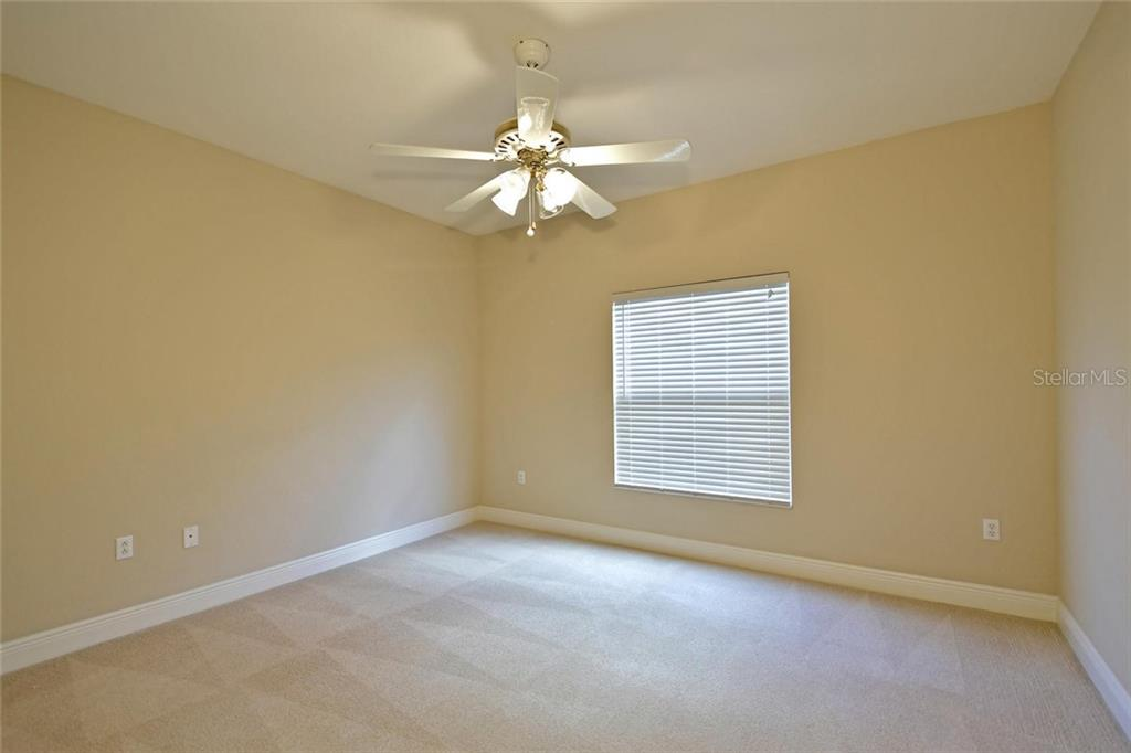 Bedroom 2 - Single Family Home for sale at 3729 Summerwind Cir, Bradenton, FL 34209 - MLS Number is A4215992