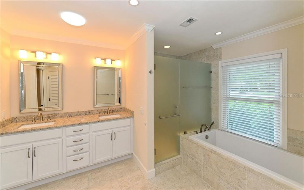 Master Ensuite Bath - Single Family Home for sale at 1670 Bay View Dr, Sarasota, FL 34239 - MLS Number is A4400079