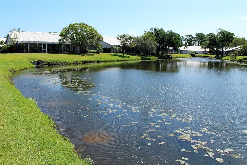 Turtles, fish and a variety of ducks and wading birds enjoy this habitat. Magnificent herons and egrets often are seen walking along the banks. - Villa for sale at 5438 Kelly Dr #12, Sarasota, FL 34233 - MLS Number is A4400319