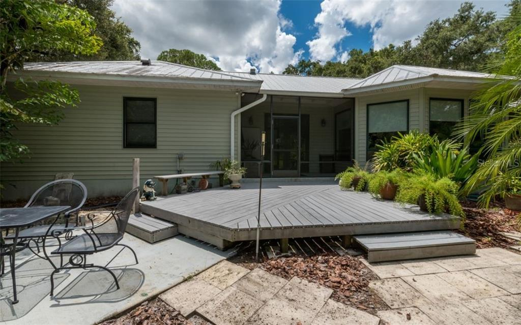 Main House Rear Open Porch - Single Family Home for sale at 7865 27th St E, Sarasota, FL 34243 - MLS Number is A4400492