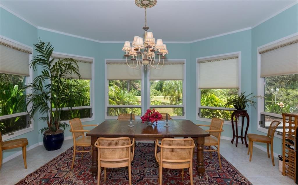 Main House Dining Room - Single Family Home for sale at 7865 27th St E, Sarasota, FL 34243 - MLS Number is A4400492