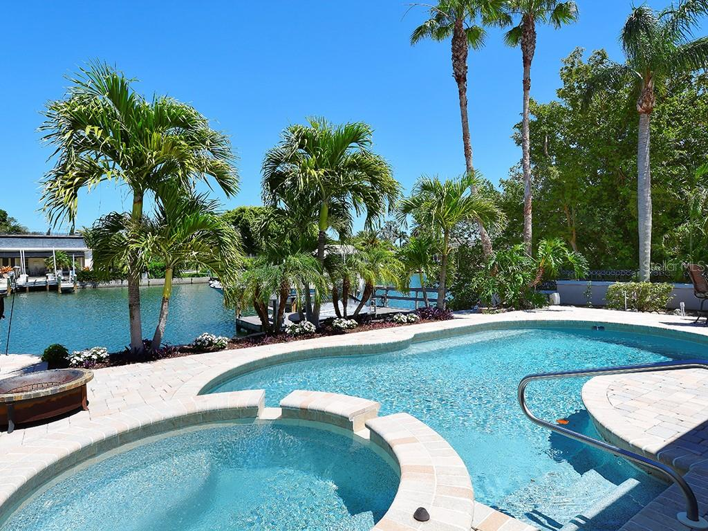 Pool and Spa Overlooking Waterway - Single Family Home for sale at 85 S Polk Dr, Sarasota, FL 34236 - MLS Number is A4400870
