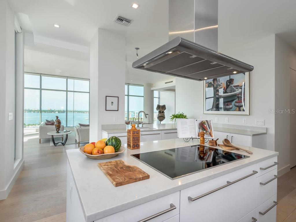 Sleek and modern Chef's Kitchen with expansive water views.  Who wouldn't want to cook in this kitchen? - Condo for sale at 1301 Main St #1001, Sarasota, FL 34236 - MLS Number is A4402790