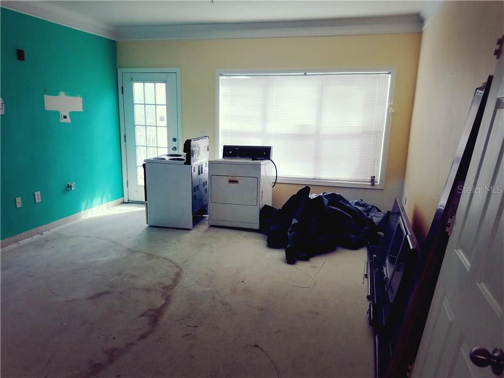 Living Room with Door Leading to Front Porch - Condo for sale at 4802 51st St W #906, Bradenton, FL 34210 - MLS Number is A4403780