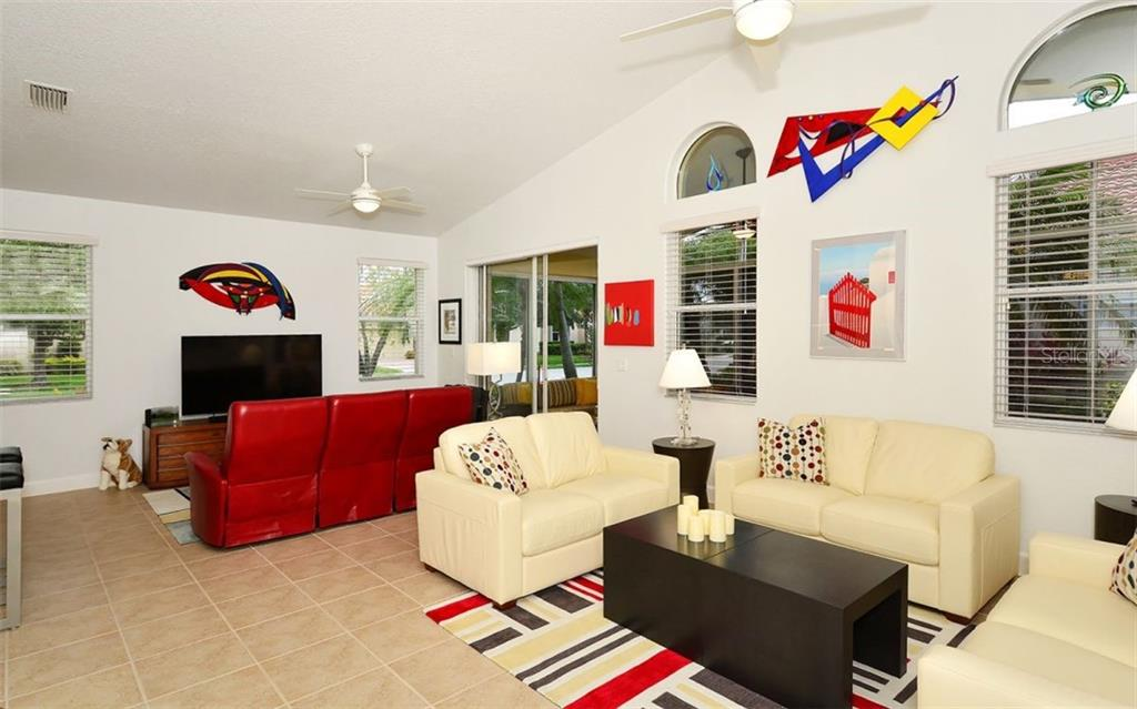 Family room & Living room - Single Family Home for sale at 6507 42nd St E, Sarasota, FL 34243 - MLS Number is A4404611