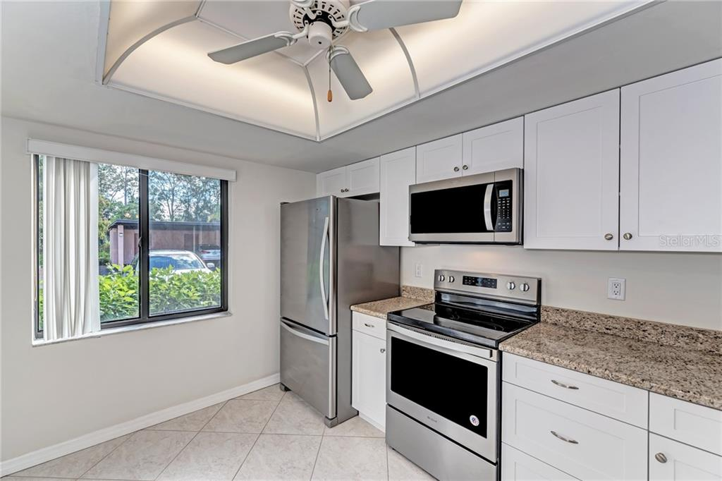 Clubhouse entertaining area - Condo for sale at 7670 Eagle Creek Dr, Sarasota, FL 34243 - MLS Number is A4406667