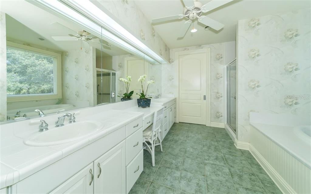 MasterSuite bathroom with dual sinks, lots of cabinetry, vanity, deep soaking garden bath, separate shower, walk-in closet and private w.c. - Single Family Home for sale at 7866 Saddle Creek Trl, Sarasota, FL 34241 - MLS Number is A4407172