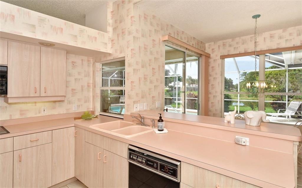 Single Family Home for sale at 8499 Woodbriar Dr, Sarasota, FL 34238 - MLS Number is A4407997