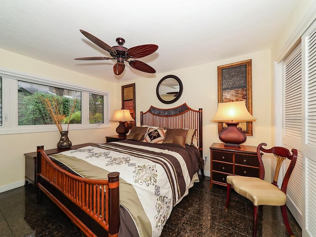 Guest Bedroom - Main house - Single Family Home for sale at 916 N Casey Key Rd, Osprey, FL 34229 - MLS Number is A4408082
