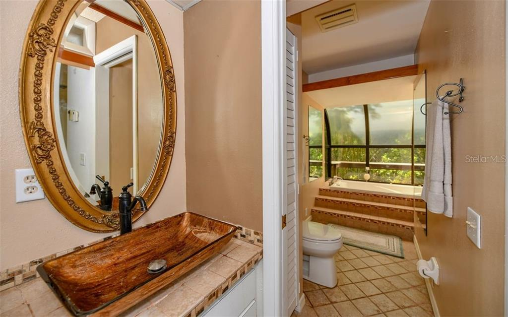 Master Bath with Tub and Tranquil Views - Single Family Home for sale at 1238 Sea Plume Way, Sarasota, FL 34242 - MLS Number is A4408272