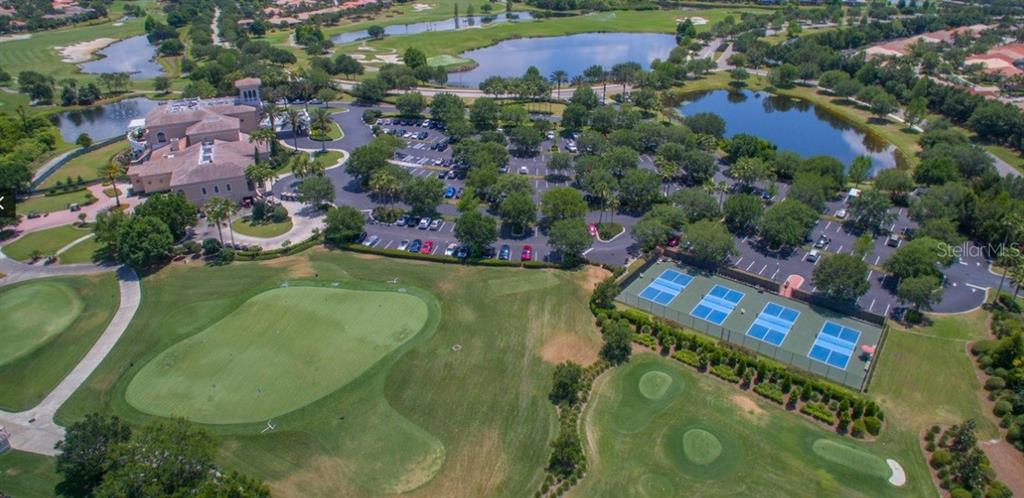 This aerial displays the beauty of the Lakewood Ranch Clubhouse - showcasing golf and tennis. - Single Family Home for sale at 13223 Palmers Creek Ter, Lakewood Ranch, FL 34202 - MLS Number is A4408290