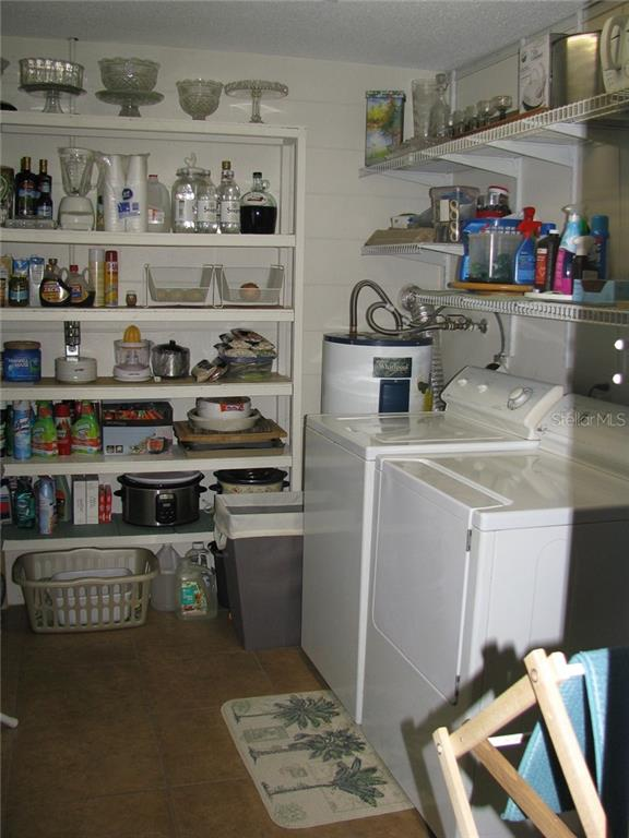 If this room doesn't have enough storage, you have too much stuff! Pantry/laundry is just off the kitchen - Single Family Home for sale at 1911 29th St W, Bradenton, FL 34205 - MLS Number is A4409585