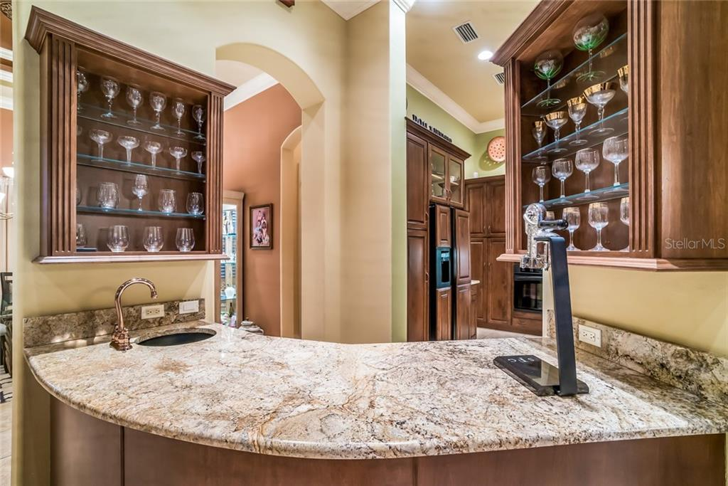 Wine Bar with Fridge - Single Family Home for sale at 7570 Preservation Dr, Sarasota, FL 34241 - MLS Number is A4409986
