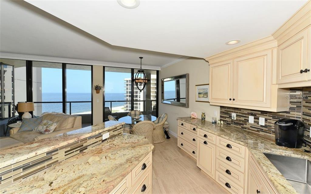 Kitchen open to living room with Gulf views - Condo for sale at 1211 Gulf Of Mexico Dr #705, Longboat Key, FL 34228 - MLS Number is A4410234