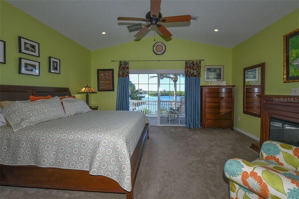 Sizable Master suite, with vaulted ceiling, and astonishing views. - Single Family Home for sale at 417 Bayview Pkwy, Nokomis, FL 34275 - MLS Number is A4411087