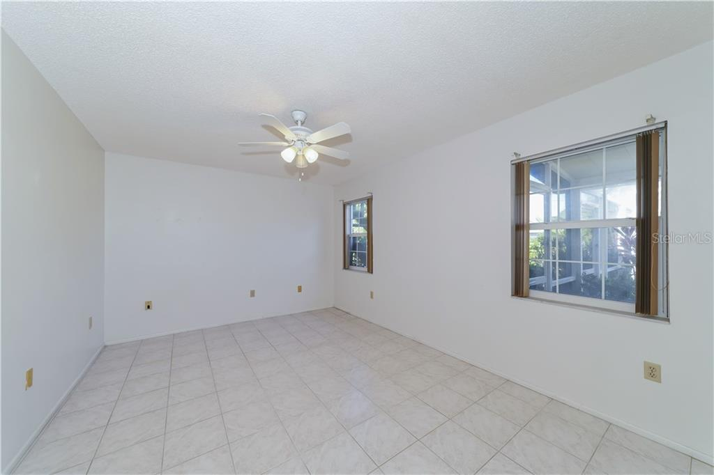First floor bedroom - Single Family Home for sale at 5591 Cape Aqua Dr, Sarasota, FL 34242 - MLS Number is A4411099