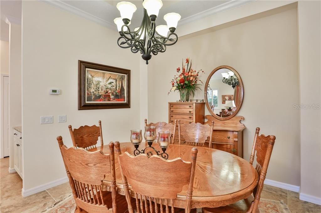 Dining room with the den in the background. - Single Family Home for sale at 11508 Griffith Park Ter, Bradenton, FL 34211 - MLS Number is A4412167