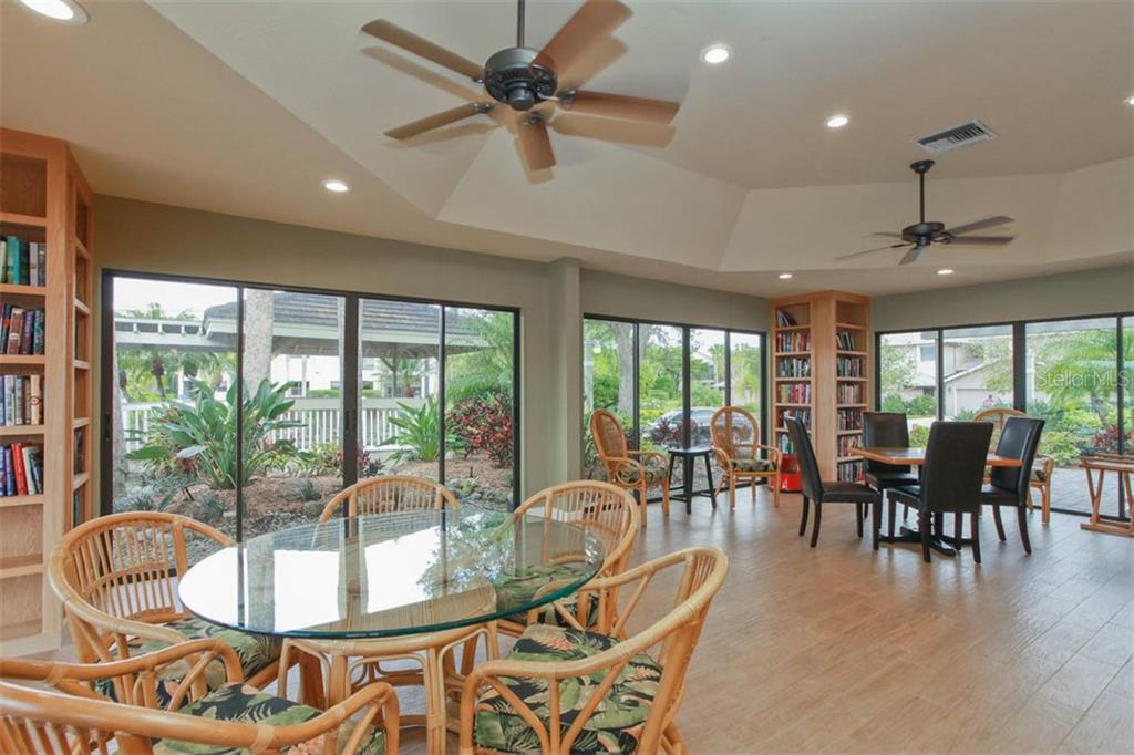 Club room complete with library; there's also a meeting room w/catering kitchen available. - Condo for sale at 1716 Starling Dr #204, Sarasota, FL 34231 - MLS Number is A4412237