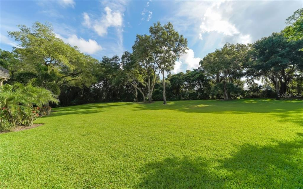 Backyard - sprawling green grass. - Single Family Home for sale at 3183 Dick Wilson Dr, Sarasota, FL 34240 - MLS Number is A4412326