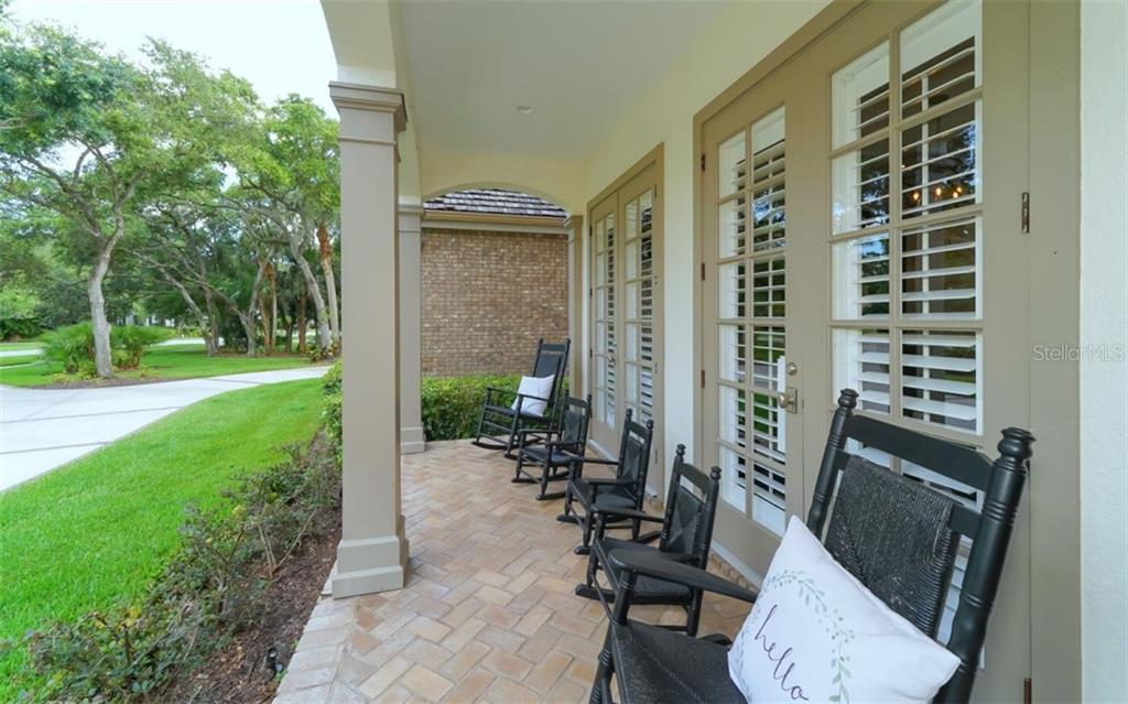 A porch made for rocking. - Single Family Home for sale at 3183 Dick Wilson Dr, Sarasota, FL 34240 - MLS Number is A4412326