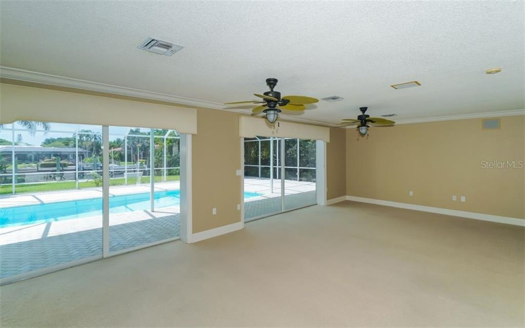 Shows even more of the living room space. - Single Family Home for sale at 390 Bob White Dr, Sarasota, FL 34236 - MLS Number is A4413388
