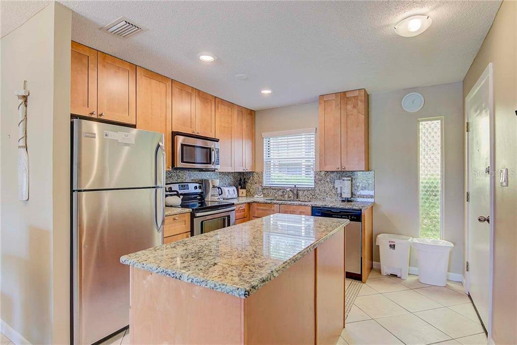 New Remodeled Kitchen with Wall Removed - Condo for sale at 925 Beach Rd #107b, Sarasota, FL 34242 - MLS Number is A4413716