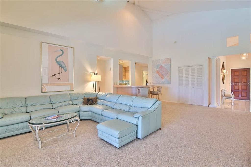 Looking back into the great room. - Villa for sale at 7686 Calle Facil, Sarasota, FL 34238 - MLS Number is A4413755