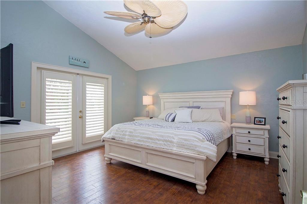 Master Bedroom with French Doors to Private Deck - Single Family Home for sale at 1205 Sea Plume Way, Sarasota, FL 34242 - MLS Number is A4414083