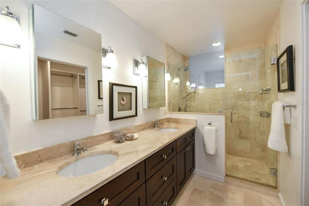 Updated Master Bathroom; dual sinks, walk-in shower, with towel warming bar. - Single Family Home for sale at 550 Ohio Pl, Sarasota, FL 34236 - MLS Number is A4414310